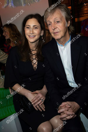 Stock Picture of Paul McCartney, Nancy Shevell. Musician Paul McCartney, right, and his wife Nancy Shevell attend the Stella McCartney Ready To Wear Spring-Summer 2020 collection, unveiled during the fashion week, in Paris