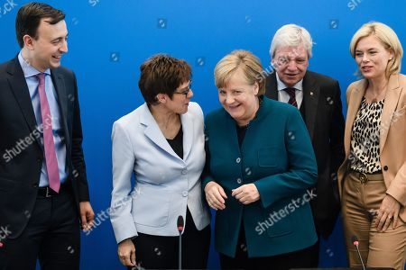 Christian Democratic Union (CDU) party chairwoman Annegret Kramp-Karrenbauer (2-L) and German Chancellor Angela Merkel (3-L) pose for media next to Christian Democratic Union (CDU) Secretary General Paul Ziemiak (L), Hesse State Premier and Christian Democratic Union (CDU) deputy chairman Volker Bouffier (4-L) and German Minister of Food and Agriculture and Christian Democratic Union (CDU) deputy leader Julia Kloeckner (R) during a party's board meeting at the CDU headquarter in Berlin, Germany, 30 September 2019.