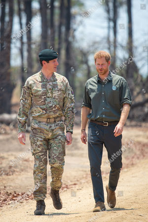 Stock Picture of Prince Harry, with Brigadier Tom Bateman (left), arrives at the memorial site for Guardsman Mathew Talbot of the Coldstream Guards at the Liwonde National Park in Malawi, on day eight of the royal tour of Africa. Guardsman Talbot lost his life in May 2019 on a joint anti-poaching patrol with local park rangers.