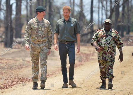 Prince Harry, with Brigadier Tom Bateman (left), arrives at the memorial site for Guardsman Mathew Talbot of the Coldstream Guards at the Liwonde National Park in Malawi, on day eight of the royal tour of Africa. PA Photo. Picture date: Monday September 30, 2019. Guardsman Talbot lost his life in May 2019 on a joint anti-poaching patrol with local park rangers.