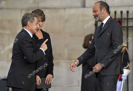 Former French president Nicolas Sarkozy and wife Carla Bruni-Sarkozy and Edouard Philippe