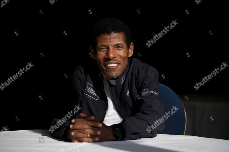 Former marathon world record holder Ethiopia's Haile Gebrselassie, poses for photographers at a hotel in London. Gebrselassie says it was wrong to hold the track and field world championships in Qatar and marathon runners could have died from the heat. The women's marathon Friday, Sept. 27, 2019 started at midnight to dodge the worst of the heat in Qatar but was still held in humidity that made it feel like 105 degrees (40 Celsius). Twenty-eight of the 68 women dropped out and one was briefly hospitalized