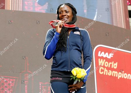 Stock Photo of Alysia Montano of the USA reacts on the podium after receiving the bronze medal during the IAAF World Athletics Championships 2019 at the Khalifa Stadium in Doha, Qatar, 30 September 2019, after being promoted to 3rd place for her performance in the women's 800m final at the IAAF World Championships 2013. The IAAF World Championships in Doha see the reallocation of a number of world championship medals. These upgrades follow the disqualification of the results of the original medalists after their sanction for anti-doping rule violations.