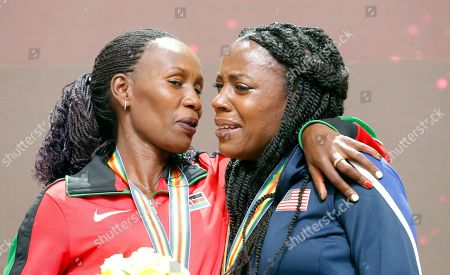 Janeth Jepkosgei Busienei (L) of Kenya reacts after receiving the silver medal during the IAAF World Athletics Championships 2019 at the Khalifa Stadium in Doha, Qatar, 30 September 2019, after being promoted to 2nd place for her performance in the women's 800m final at the IAAF World Championships 2011. At right Alysia Montano of the USA, who received the bronze medal for the same competition. The IAAF World Championships in Doha see the reallocation of a number of world championship medals. These upgrades follow the disqualification of the results of the original medalists after their sanction for anti-doping rule violations.