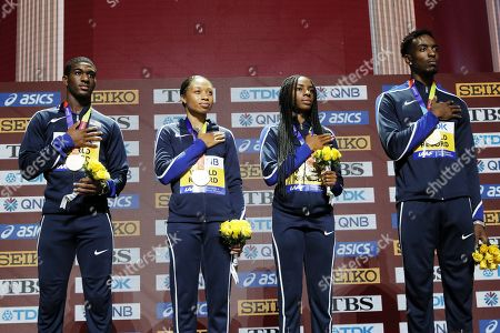 Gold medalists (from left) Wilbert London, Allyson Felix, Courtney Okolo and Michael Cherry of USA during the medal ceremony for the Mixed 400m Relay at the IAAF World Athletics Championships 2019 at the Khalifa Stadium in Doha, Qatar, 30 September 2019.