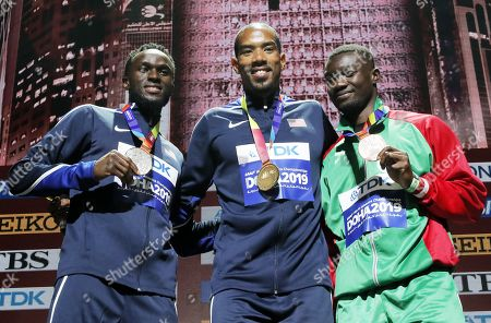 Stock Picture of Gold medalist Christian Taylor (C) of USA, silver medalist Will Claye (L) of USA and bronze medalist Hugues Fabrice Zango of Burkina Faso during the medal ceremony for the Men's Triple Jump at the IAAF World Athletics Championships 2019 at the Khalifa Stadium in Doha, Qatar, 30 September 2019.