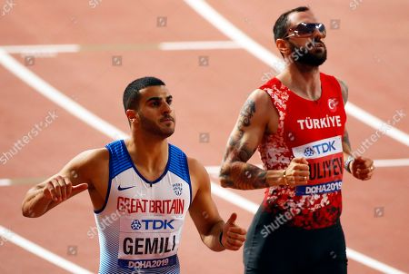 Adam Gemili (L) of Britain and Ramil Guliyev (R) of Turkey react after competing in the men's 200m semi finals at the IAAF World Athletics Championships 2019 at the Khalifa Stadium in Doha, Qatar, 30 September 2019.