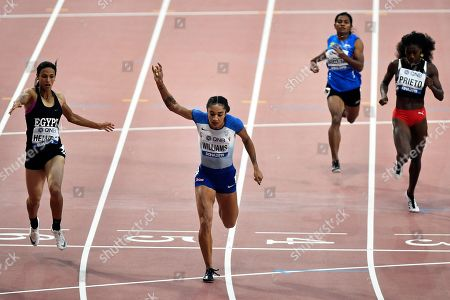 Bassant Hemida, of Egypt, Jodie Williams, of Great Britain, Archana Suseentran, of India, and Mauricia Prieto, of Trinidad And Tobago, from left to right, compete in the women's 200 meter heats during the World Athletics Championships in Doha, Qatar
