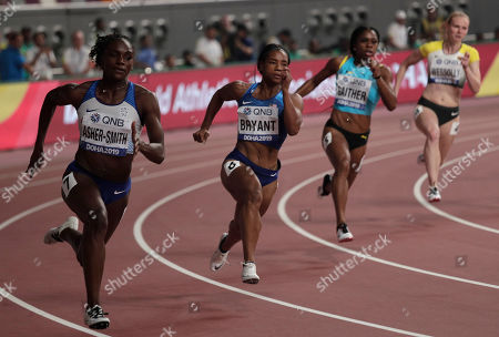 Dina Asher-Smith, of Great Britain, Dezerea Bryant, of the United States, Tynia Gaither, of Bahamas and Jessica-Bianca Wessolly, of Germany, compete in a women's 200 meter heat at the World Athletics Championships in Doha, Qatar