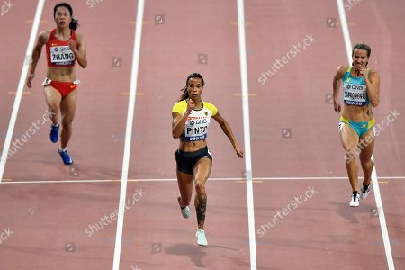 Stock Photo of Man Zhang, of China, Tatjana Pinto, of Germany, and Olga Safronova, of Kazakhstan, from left to right, compete in the women's 200 meter heats during the World Athletics Championships in Doha, Qatar