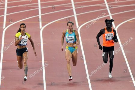 Stock Image of Tatjana Pinto, of Germany, Olga Safronova, of Kazakhstan, and Aminatou Seyni, of Niger,from left to right, compete in the women's 200 meter heats during the World Athletics Championships in Doha, Qatar
