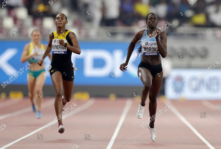 Stephenie Ann McPherson, of Jamaica, left, and Galefele Moroko, of Botswana race in a women's 400 meter heat at the World Athletics Championships in Doha, Qatar