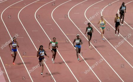 Stock Photo of Athletes, from left, Roxana Gómez, of Cuba, Kendall Ellis, of the United States, Aliyah Abrams, of Guyana, Maggie Barrie, of Sierra Leone, Favour Ofili, of Nigeria, Gabriella O'Grady, of Australia, Stephenie Ann McPherson, of Jamaica, and Galefele Moroko, of Botswana race in a women's 400 meter heat at the World Athletics Championships in Doha, Qatar