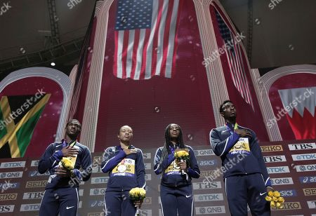 The gold medal winning United States team of Wilbert London, Allyson Felix, Courtney Okolo and Michael Cherry, from left, take part in the medal ceremony for the mixed 4x400 meter relay at the World Athletics Championships in Doha, Qatar