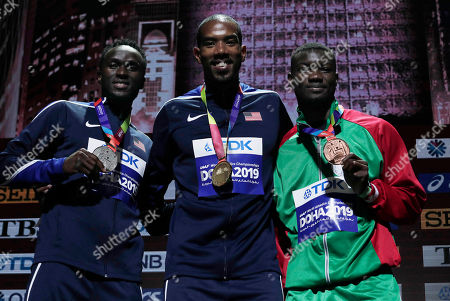 Medalists in the men's triple jump Christian Taylor of the United States, gold, center, Will Claye of the United States, silver, left, and Hugues Fabrice Zango of Burkina Faso, bronze, pose during the medal ceremony at the World Athletics Championships in Doha, Qatar