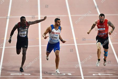 Aaron Brown, of Canada, Adam Gemili, of Great Britain, and Ramil Guliyev, of Turkey, from left to right, compete in the men's 200 meter semifinals during the World Athletics Championships in Doha, Qatar