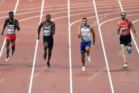 Jereem Richards, of Trinidad And Tobago, Aaron Brown, of Canada, Adam Gemili, of Great Britain, and Ramil Guliyev, of Turkey, from left to right, compete in the men's 200 meter semifinals during the World Athletics Championships in Doha, Qatar