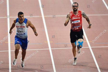 Adam Gemili, of Great Britain, and Ramil Guliyev, of Turkey, right, compete in the men's 200 meter semifinals during the World Athletics Championships in Doha, Qatar