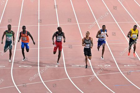 Stock Picture of Anaso Jobodwana, of South Africa, Taymir Burnet, of the Netherlands, Kyle Greaux, of Trinidad And Tobago, Andre De Grasse, of Canada, Zharnel Hughes, of Great Britain, and Yohan Blake, of Jamaica, from left to right, compete in the men's 200 meter semifinals during the World Athletics Championships in Doha, Qatar