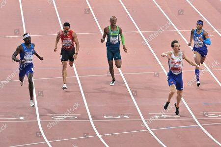Stock Photo of Rai Benjamin, of the United States, Yasmani Copello, of Turkey, Alison Dos Santos, of Brazil, Karsten Warholm, of Norway, and Tj Holmes, of the United States, from left to right, competes in the men's 400 meter hurdles final during the World Athletics Championships in Doha, Qatar