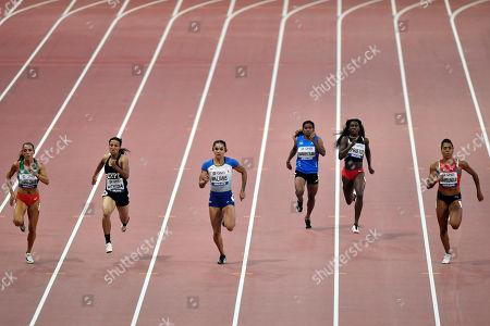 Ivet Lalova-Collio, of Bulgaria, Bassant Hemida, of Egypt, Jodie Williams, of Great Britain, Archana Suseentran, of India, Mauricia Prieto, of Trinidad And Tobago, and Mujinga Kambundji, of Switzerland, from left to right, compete in the women's 200 meter heats during the World Athletics Championships in Doha, Qatar