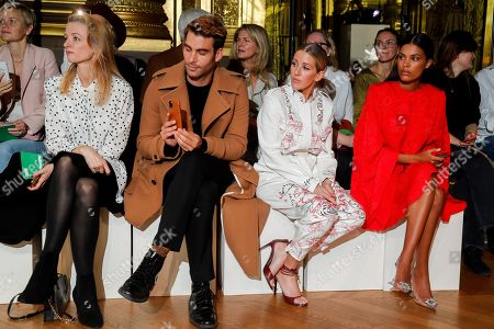 Stock Photo of Ellie Goulding and Tina Kunakey di Vita in the front row