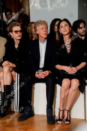 Natalia Vodianova, Nancy Shevell and Sir Paul McCartney in the front row