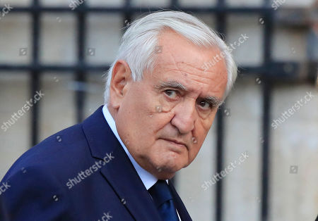 Former French Prime Minister Jean-Pierre Raffarin arrives at Saint Sulpice church in Paris, . Past and current heads of states are gathering in Paris to pay tribute to former French president Jacques Chirac. A private family church service for Chirac, who died last week at the age of 86, is taking place Monday