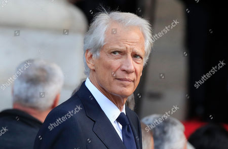 Stock Photo of Former French Prime Minister Dominique de Villepin arrives at Saint Sulpice church in Paris, . Past and current heads of states are gathering in Paris to pay tribute to former French president Jacques Chirac. A private family church service for Chirac, who died last week at the age of 86, is taking place Monday