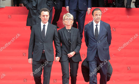 Martin Rey-Chirac, left, Claude Chirac, center, son and daughter of former President Jacques Chirac, and Claude's husband Frédéric Salat-Baroux, right, leave the Saint Sulpice church in Paris, . Past and current heads of states are gathering in Paris to pay tribute to former French president Jacques Chirac. A private family church service for Chirac, who died last week at the age of 86, is taking place Monday