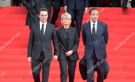 Martin Rey-Chirac, left, Claude Chirac, center, son and daughter of former President Jacques Chirac, and Claude's husband FrÈdÈric Salat-Baroux, right, leave the Saint Sulpice church in Paris, . Past and current heads of states are gathering in Paris to pay tribute to former French president Jacques Chirac. A private family church service for Chirac, who died last week at the age of 86, is taking place Monday