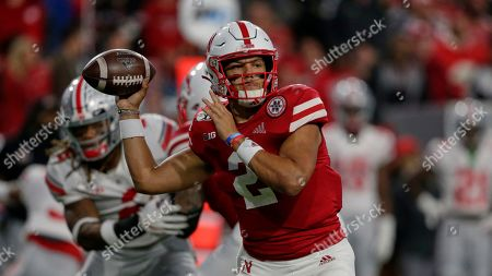 Stock Image of Nebraska quarterback Adrian Martinez (2) throws a pass during the first half of an NCAA college football game against Ohio State in Lincoln, Neb