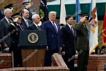 Donald Trump, Mark Milley, Mike Pence, Joseph Dunford. President Donald Trump participates in an Armed Forces welcome ceremony for the new chairman of the Joint Chiefs of Staff, Gen. Mark Milley, left, at Joint Base Myer-Henderson Hall, Va. From left are Chairman of the Joint Chiefs of Staff, Gen. Mark Milley, Vice President Mike Pence, Trump, Secretary of Defense Mark Esper and Gen. Joseph Dunford, former chairman