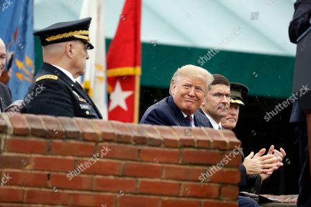 Donald Trump, Mark Milley, Joseph Dunford. President Donald Trump participates in an Armed Forces welcome ceremony for the new chairman of the Joint Chiefs of Staff, Gen. Mark Milley, left, at Joint Base Myer-Henderson Hall, Va. From left are Chairman of the Joint Chiefs of Staff, Gen. Mark Milley, Trump, Secretary of Defense Mark Esper and Gen. Joseph Dunford, former chairman