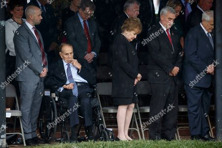 Bob Dole, Elizabeth Dole. Former Sen. Bob Dole, second from left, and his wife Elizabeth Dole, third from left, listen during an Armed Forces welcome ceremony for the new chairman of the Joint Chiefs of Staff, Gen. Mark Milley, at Joint Base Myer-Henderson Hall, Va