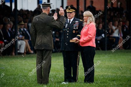Joseph Dunford, Mark Milley, Hollyanne Mille. Outgoing chairman of the Joint Chiefs of Staff Gen. Joseph Dunford, left, participates in a ceremonial swearing in ceremony for the new chairman of the Joint Chiefs of Staff Gen. Mark Milley, as Hollyanne Mille looks, at Joint Base Myer-Henderson Hall, Va