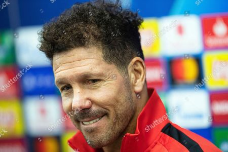 Atletico Madrid head coach Diego Simeone smiles during a press conference before a training session at the Lokomotiv Stadium in Moscow, Russia, . Lokomotiv Moscow will face Atletico Madrid at the Group D Champions League soccer match on Thursday, Oct. 1
