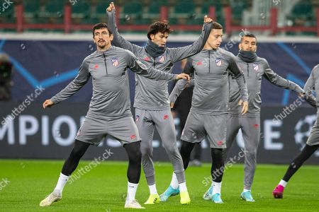 Stock Photo of Joao Felix, Stefan Savic, Angel Correa, Ivan Saponjic. From left: Atletico Madrid's Stefan Savic, Joao Felix, Ivan Saponjic and Angel Correa attend a training session at the Lokomotiv Stadium in Moscow, Russia, . Lokomotiv Moscow will face Atletico Madrid at the Group D Champions League soccer match on Thursday, Oct. 1