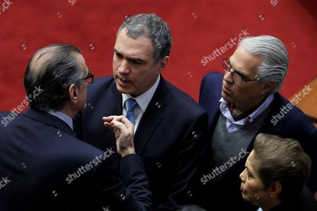 Peruvian Prime Minister Salvador del Solar (C) speaks to the President of the Congress Pedro Olaechea (L), during the session in which the Government seeks to reform the process to elect the judges of the Constitutional Court, in Lima, Peru, 30 September 2019. The Peruvian Congress and Government are heading to the highest point of crisis following the warning of President Martin Vizcarra that he will dissolve Parliament if the legislators do not give priority to his request for a question of trust before proceeding with their controversial election of the magistrates of the Constitutional Court.