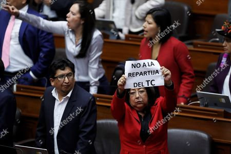 Peruvian congressmen protest during a session in which the Government seeks to reform the process to elect the judges of the Constitutional Court, in Lima, Peru, 30 September 2019. The Peruvian Congress and Government are heading to the highest point of crisis following the warning of President Martin Vizcarra that he will dissolve Parliament if the legislators do not give priority to his request for a question of trust before proceeding with their controversial election of the magistrates of the Constitutional Court.