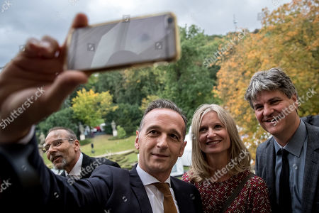 German Foreign Minister Heiko Maas (2-L) takes selfie photo with former refugees on balcony at German embassy during ceremony marking the 30th anniversary of East Germans' exodus into West German embassy in Prague, Czech Republic, 30 September 2019. In September 1989, over 4,000 GDR citizens, many of them arrived in their Trabant-brand cars, climbed over the fence into the gardens of the West German Embassy in Prague where on 30 September 1989 West German Foreign Minister Hans-Dietrich Genscher addressed them his legendary speech from the embassy's balcony in which he informed them their departure to West Germany was granted.