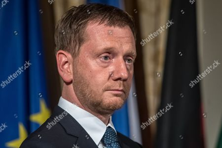Stock Image of Saxony Prime Minister Michael Kretschmer attends the ceremony marking the 30th anniversary of East Germans' exodus into West German embassy at German embassy in Prague, Czech Republic, 30 September 2019. In September 1989, over 4,000 GDR citizens, many of them arrived in their Trabant-brand cars, climbed over the fence into the gardens of the West German Embassy in Prague where on 30 September 1989 West German Foreign Minister Hans-Dietrich Genscher addressed them his legendary speech from the embassy's balcony in which he informed them their departure to West Germany was granted.