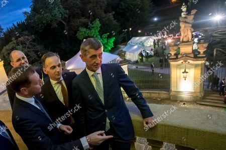 Stock Photo of (L-R) Saxony Prime Minister Michael Kretschmer, German Ambassador to Czech Republic Christoph Israng, German Foreign Minister Heiko Maas and Czech Prime Minister Andrej Babis talk on balcony during the ceremony marking the 30th anniversary of East Germans' exodus into West German embassy at German embassy in Prague, Czech Republic, 30 September 2019. In September 1989, over 4,000 GDR citizens, many of them arrived in their Trabant-brand cars, climbed over the fence into the gardens of the West German Embassy in Prague where on 30 September 1989 West German Foreign Minister Hans-Dietrich Genscher addressed them his legendary speech from the embassy's balcony in which he informed them their departure to West Germany was granted.