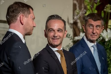 (L-R) Saxony Prime Minister Michael Kretschmer, German Foreign Minister Heiko Maas and Czech Prime Minister Andrej Babis attend the ceremony marking the 30th anniversary of East Germans' exodus into West German embassy at German embassy in Prague, Czech Republic, 30 September 2019. In September 1989, over 4,000 GDR citizens, many of them arrived in their Trabant-brand cars, climbed over the fence into the gardens of the West German Embassy in Prague where on 30 September 1989 West German Foreign Minister Hans-Dietrich Genscher addressed them his legendary speech from the embassy's balcony in which he informed them their departure to West Germany was granted.