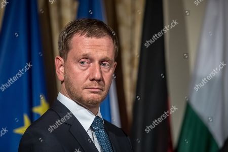 Saxony Prime Minister Michael Kretschmer attends the ceremony marking the 30th anniversary of East Germans' exodus into West German embassy at German embassy in Prague, Czech Republic, 30 September 2019. In September 1989, over 4,000 GDR citizens, many of them arrived in their Trabant-brand cars, climbed over the fence into the gardens of the West German Embassy in Prague where on 30 September 1989 West German Foreign Minister Hans-Dietrich Genscher addressed them his legendary speech from the embassy's balcony in which he informed them their departure to West Germany was granted.