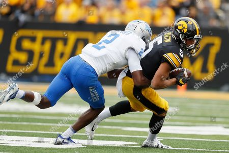 Iowa wide receiver Oliver Martin (5) catches a pass in front of Middle Tennessee defensive back Chris Stamps, left, during the second half of an NCAA college football game, in Iowa City, Iowa. Iowa won 48-3
