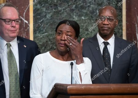 Alysia Montano, Jim Carroll, Edwin Moses. Alysia Montano is flanked by Jim Carroll, deputy director of the Office of National Drug Control Policy, left, and Edwin Moses, chairman of the U.S. Anti-Doping Agency, as she wipes away tears as she recounts her experience finishing behind two Russian runners using performance-enhancing drugs, during a White House event aimed at reforming the World Anti-Doping Agency, in Washington. On, Montano walked off the track at the World Championships in Doha, Qatar, with a pair of bronze medals that were placed around her neck several years too late. The U.S. 800-meter runner who has stood up on behalf of every athlete who has ever kept off the medals stand by a doper finally got the third-place prizes she was robbed of at two straight worlds, back in 2011 and 2013