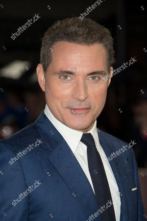 Rufus Sewell poses for photographers upon arrival at the premiere of the film 'Judy' in central London