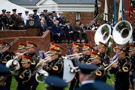 Donald Trump, Mark Esper, Joseph Dunford, Mike Pence. Seated front row from left; Vice President Mike Pence, President Donald Trump, Defense Secretary Mark Esper and former chairman Gen. Joseph Dunford watch the U.S. Army Band march during a ceremony welcoming Chairman of the Joint Chiefs of Staff Gen. Mark Milley, at Joint Base Myer-Henderson Hall, Va