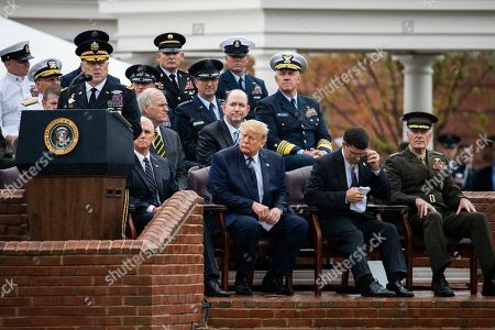 Donald Trump, Mark Esper, Joseph Dunford, Mike Pence, Mark Milley. From second left; Vice President Mike Pence, President Donald Trump, Defense Secretary Mark Esper and outgoing chairman of the Joint Chiefs of Staff Gen. Joseph Dunford, listen to Chairman of the Joint Chiefs of Staff Gen. Mark Milley, left, during a ceremony at Joint Base Myer-Henderson Hall, Va